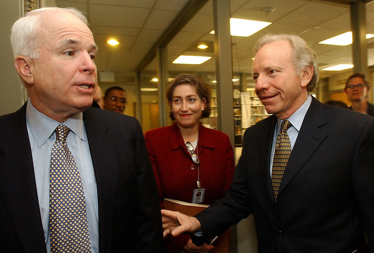 climate2/010803 -- Sens. John McCain, R-Ariz., and Joe Lieberman, D-Conn., enter a press conference in the Senate Studio prior to a hearing on the American Investments for Reductions of Emmisions Act of 2003 which would gradually establish restrictions on greenhouse gas emmissions.