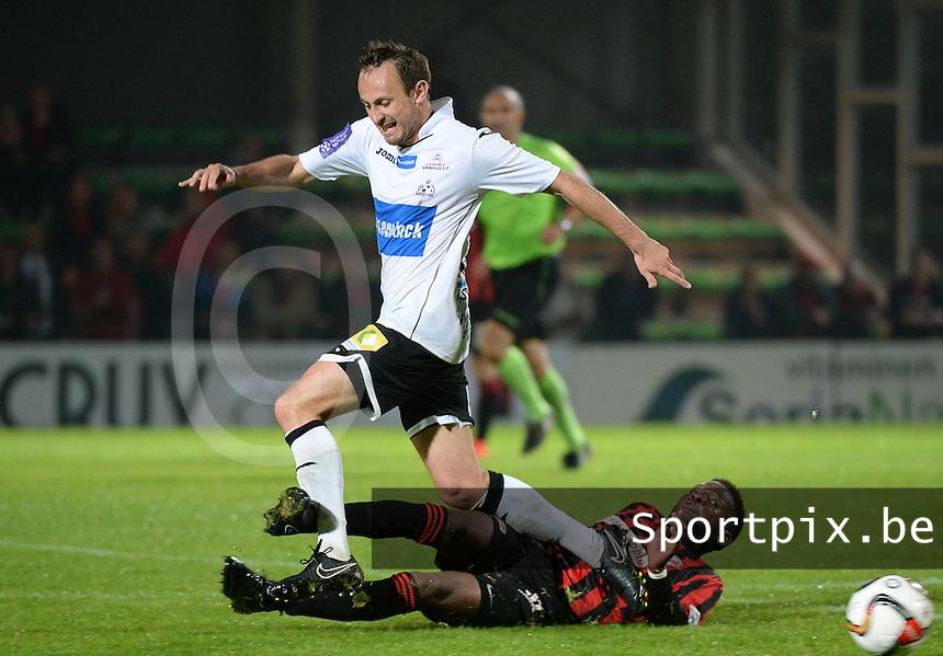 KSV Roeselare - Seraing : Rodrigue Dikaba (r) met de tackle op Mickael Seoudi (links) <br /> foto VDB / BART VANDENBROUCKE