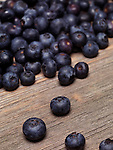 Closeup of organic blueberries on rustic wood background