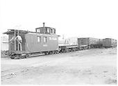 D&amp;RGW long caboose #0503 with two workmen on open vestibule.<br /> D&amp;RGW  La Jara, CO  Taken by Payne, Andy M. - 8/21/1954