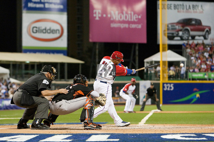 9 March 2009: #4 Yadier Molina of Puerto Rico hits the ball during the 2009 World Baseball Classic Pool D game 4 at Hiram Bithorn Stadium in San Juan, Puerto Rico. Puerto Rico wins 3-1 over Netherlands