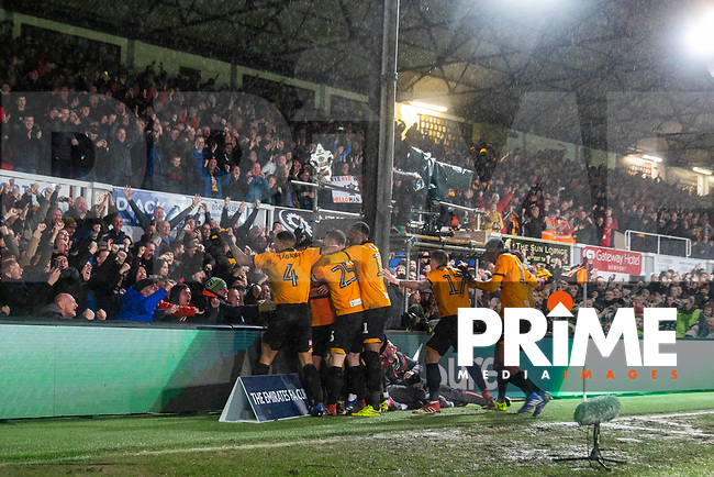 Newport players celebrate their side's second goal during the FA Cup 4th round replay match between Newport County and Middlesbrough at Rodney Parade, Newport, Wales on 5 February 2019. Photo by Mark  Hawkins / PRiME Media Images.