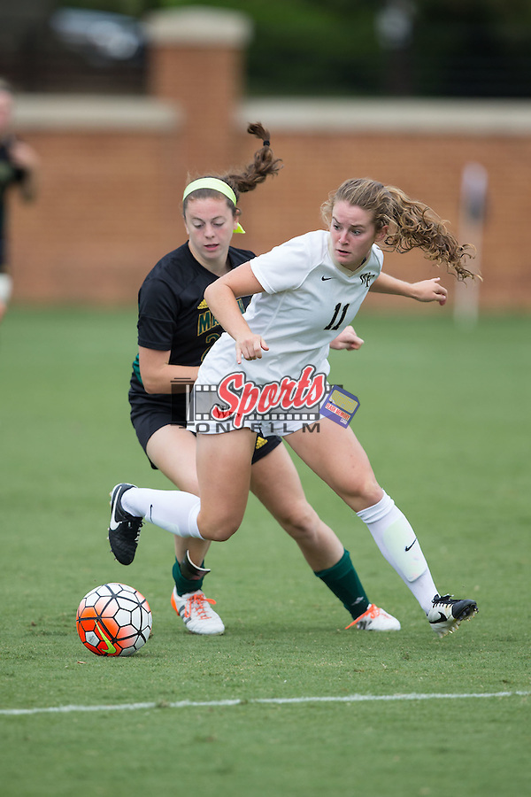 Maddie Huster (11) of the Wake Forest Demon Deacons keeps the ball away from Erin Mitchell (28) of the George Mason Patriots during second half action at Spry Soccer Stadium on September 13, 2015 in Winston-Salem, North Carolina.  The Demon Deacons defeated the Patriots 1-0.  (Brian Westerholt/Sports On Film)