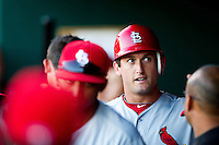 David Freese (23) of the St. Louis Cardinals is congratulated in the dugout after scoring during a game against the Springfield Cardinals at Hammons Field on April 2, 2012 in Springfield, Missouri. (David Welker/Four Seam Images)
