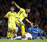 Maurice Edu slides through Manuel Pascali to win the ball