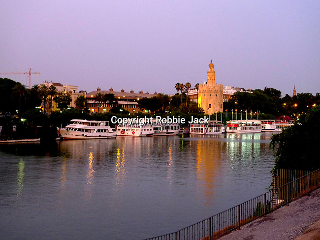 A view across the Gaudalquivir to the Torre del Oro in Seville, Spain.