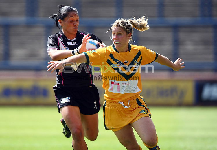 PICTURE BY VAUGHN RIDLEY/SWPIX.COM - Rugby League - Festival of World Cups, Women's Final - Australia Women v New Zealand Women - Headingley, Leeds, England - 14/07/13 - New Zealand's Sarina Fiso and Australia's Jessica Palmer.