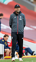 5th July 2020, Anfield, Liverpool, England;  Liverpools manager Jurgen Klopp watches from the sideline during the Premier League match between Liverpool and Aston Villa at Anfield in Liverpool