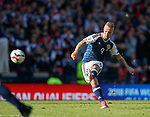 Leigh Griffiths scores the first goal for Scotland