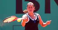 Julie Coin (FRA) against Kateryna Bondarenko (UKR) (32) in the first rond of the women's singles. Kateryna Bondarenko beat Julie Coin 6-1 6-2..Tennis - French Open - Day 2 - Mon 24 May 2010 - Roland Garros - Paris - France..© FREY - AMN Images, 1st Floor, Barry House, 20-22 Worple Road, London. SW19 4DH - Tel: +44 (0) 208 947 0117 - contact@advantagemedianet.com - www.photoshelter.com/c/amnimages