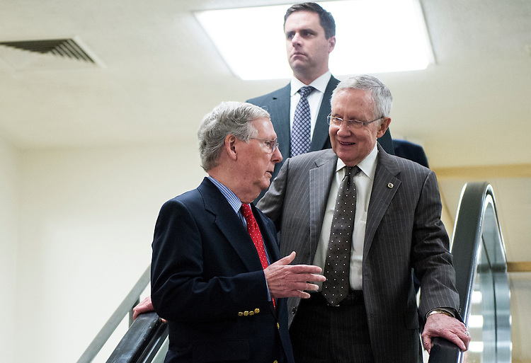 UNITED STATES - SEPTEMBER 11: Senate Minority Leader Mitch McConnell, R-Ky., left, and Senate Majority Leader Harry Reid, D-Nev., arrive for the Senate closed briefing in the Capitol on the White House strategy on ISIL on Thursday, Sept. 11, 2014. (Photo By Bill Clark/CQ Roll Call)