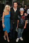 """HOLLYWOOD, CA. - April 30: Tori Spelling, Dean McDermott and guest arrive at the Los Angeles premiere of """"Star Trek"""" at the Grauman's Chinese Theater on April 30, 2009 in Hollywood, California.a"""