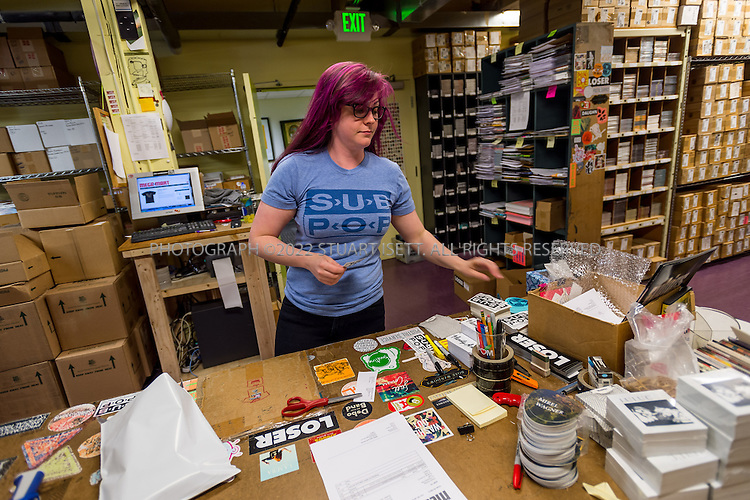 7/1/2014&mdash;Seattle, WA, USA<br /> <br /> Sub Pop Records employee, Andrea Heart, 29, packing up merchandise for shipping from the company's offices in Seattle, WA.<br /> <br /> Photograph by Stuart Isett<br /> &copy;2014 Stuart Isett. All rights reserved.