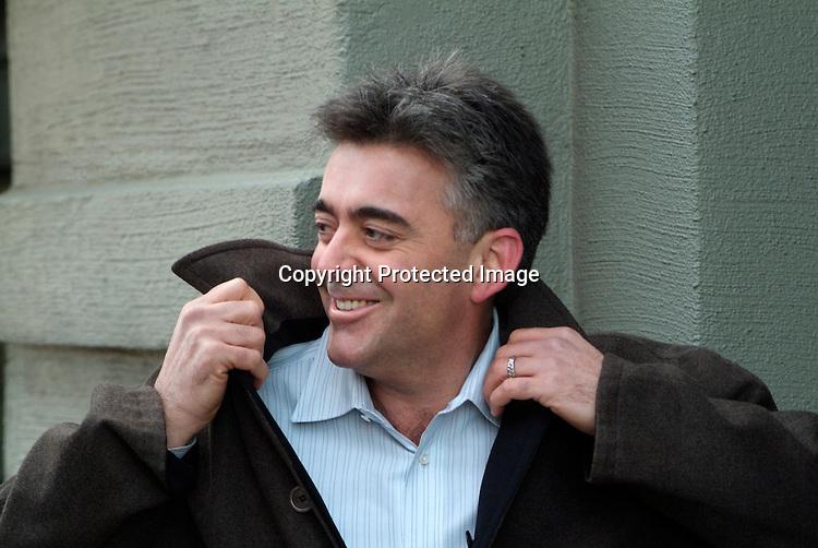 Man smiling wearing winter coat