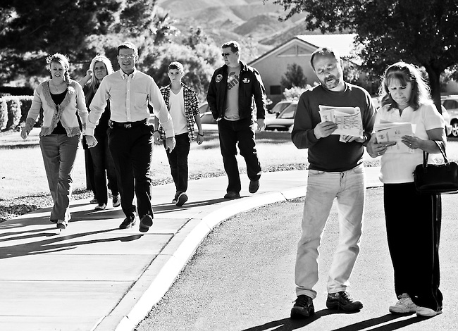 Dr. Joe Heck, Republican candidate running against Rep. Dina Titus, arrives with his family to vote at the Desert Willows Golf Course in Henderson, Nev., on Nov. 2, 2010.