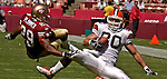San Francisco 49ers defensive back Ahmed Plummer (29) stops Cleveland Browns tight end Andre Shea (80) on Sunday, September 21, 2003, in San Francisco, California. The Browns defeated the 49ers 13-12.
