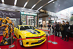 "Dec 15, 2011, Tokyo, Japan - People take photos of the large scale figure of Bumblebee from the movie, ""Transformers Dark Side of the Moon"" is displayed at a electronics store in downtown Tokyo. The ""Transformers Dark Side of the Moon"" DVD will be released in Japan on December 16. (Photo by Christopher Jue/AFLO)"