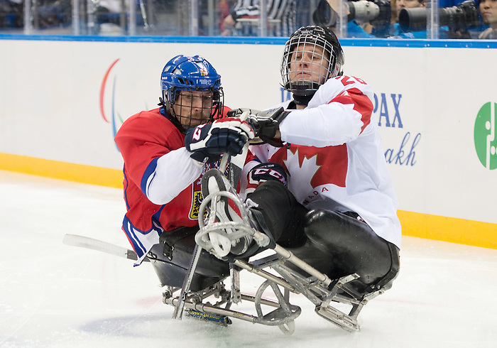 Sochi, RUSSIA - Mar 11 2014 -  Dominic Larocque collides with a Czech player as Canada takes on Czech Republic in Sledge Hockey at the 2014 Paralympic Winter Games in Sochi, Russia.  (Photo: Matthew Murnaghan/Canadian Paralympic Committee)