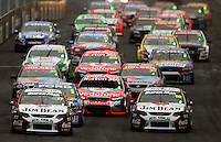 Jim Beam Racing's Steven Johnson (front left) and James Courtney (front right) head the field at the start of the feature race during Day Three of the Hamilton 400 Aussie V8 Supercars Round Two at Frankton, Hamilton, New Zealand on Sunday, 19 April 2009. Photo: Dave Lintott / lintottphoto.co.nz