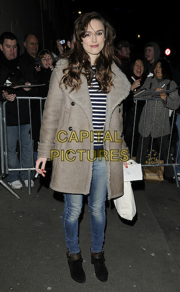 """KEIRA KNIGHTLEY.Leaving after the evening performance of """"The Misanthrope"""", Comedy Theatre, London, England, UK, .February 26th 2010..full length grey gray beige sheepskin coat jeans black ankle boots departures top blue and white striped stripes .CAP/CAN.©Can Nguyen/Capital Pictures"""