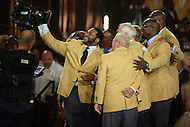 Canton, Ohio - August 6, 2015: Former NFL player Jerome Bettis takes a selfie with the HOF Class of 2015 after they accepted their gold jacket for the first time during the 2015 Pro Football Hall of Fame enshrinement dinner in Canton, Ohio August 6, 2015. With eight 1,000 plus yard seasons, Bettis was tied for third-best in NFL history and his 13,662 career rushing yards ranked him fifth all-time. (Photo by Don Baxter/Media Images International)