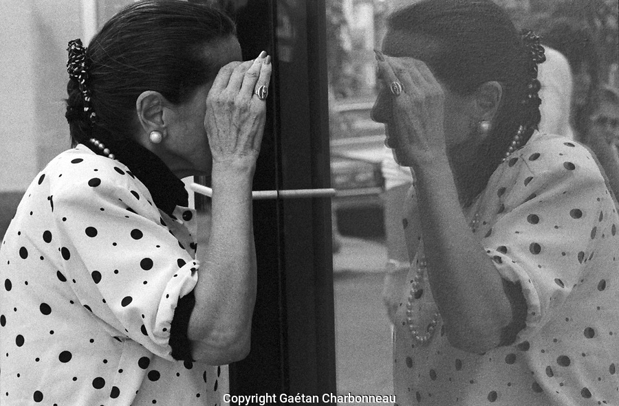 A woman looking at her own reflection