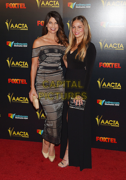 LOS ANGELES, CA - JANUARY 06: Actresses Zoe Ventoura (L) and Stephanie McIntosh arrive at the 6th AACTA International Awards at Avalon Hollywood on January 6, 2017 in Los Angeles, California.<br /> CAP/ROT/TM<br /> &copy;TM/ROT/Capital Pictures