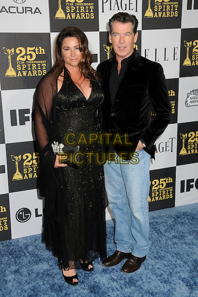 KEELY SHAYE SMITH & PIERCE BROSNAN.25th Annual Film Independent Spirit Awards - Arrivals held at the Nokia Event Deck at L.A. Live, Los Angeles, California, USA..March 5th, 2010.full length married husband wife black dress cleavage halterneck beaded shawl wrap sheer jacket jeans denim clutch bag peep toe shoes.CAP/ADM/BP.©Byron Purvis/AdMedia/Capital Pictures.