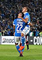 BOGOTA- COLOMBIA – 08-02-2017: John Duque (Izq.)  jugador de Millonarios de Colombia, celebra el gol anotado a Atletico Paranaense de Brasil, durante partido entre Millonarios de Colombia y Atletico Paranaense de Brasil, por la segunda fase, llave 1 de la Copa Conmebol Libertadores Bridgestone 2017,en el estadio Nemesio Camacho El Campin, de la ciudad de Bogota. / John Duque (L) player of Millonarios of Colombia, celebrates a scored goal to Atletico Paranaense of Brasil, during a match between Millonarios of Colombia and Atletico Paranaense of Brasil, for the second phase, key1, of the Conmebol Copa Libertadores Bridgestone 2017 at the Nemesio Camacho El Campin in Bogota city. VizzorImage / Luis Ramirez / Staff.