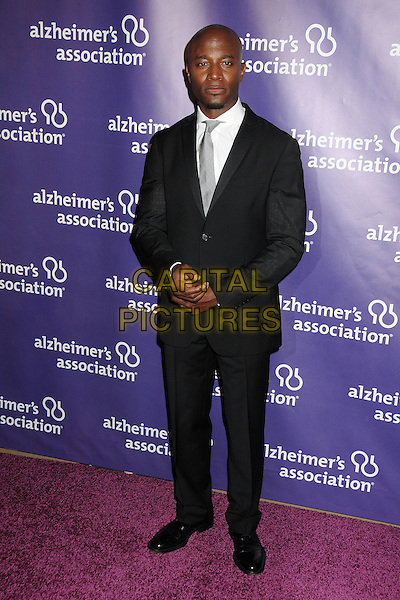 "TAYE DIGGS .19th Annual ""A Night at Sardi's"" Benefiting the Alzheimer's Association held at the Beverly Hilton Hotel, Beverly Hills, California, USA, 16th March 2011..full length black suit grey gray silver tie white shirt .CAP/ADM/BP.©Byron Purvis/AdMedia/Capital Pictures."