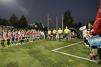 Referees walk on to the field. FC Dallas defeated the San Jose Earthquakes 2-1 at Buck Shaw Stadium in Santa Clara, California on October 7, 2009.
