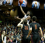 SIOUX FALLS, SD - MARCH 22: Lewis Diankulu #5 from Queens (NC) leaps over Logan Doyle #35 from Northern State for a shot during their semifinal game at the 2018 Elite Eight Men's NCAA DII Basketball Championship at the Sanford Pentagon in Sioux Falls, SD. (Photo by Dave Eggen/Inertia)