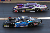 Jul. 20, 2014; Morrison, CO, USA; NHRA pro stock driver Jonathan Gray (near lane) races alongside Vincent Nobile during the Mile High Nationals at Bandimere Speedway. Mandatory Credit: Mark J. Rebilas-