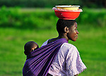 Her baby on her back, a woman walks in Karonga, a town in northern Malawi.