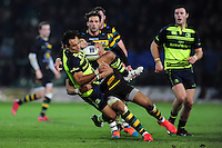 Isa Nacewa of Leinster Rugby is tackled by Luther Burrell of Northampton Saints. European Rugby Champions Cup match, between Northampton Saints and Leinster Rugby on December 9, 2016 at Franklin's Gardens in Northampton, England. Photo by: Patrick Khachfe / JMP