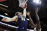 25 January 2015: Notre Dame's Pat Connaughton (24) grabs a rebound. The North Carolina State University Wolfpack played the University of Notre Dame Fighting Irish in an NCAA Division I Men's basketball game at the PNC Arena in Raleigh, North Carolina. Notre Dame won the game 81-78 in overtime.