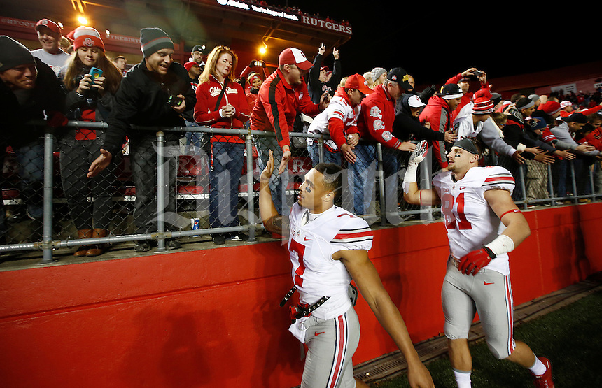 Ohio State Buckeyes tight end Nick Vannett (81) and Ohio State Buckeyes wide receiver Jalin Marshall (7) celebrate with fans after the college football game between the Rutgers Scarlet Knights and the Ohio State Buckeyes at High Point Solutions Stadium in Piscataway, NJ, Saturday night, October 24, 2015. The Ohio State Buckeyes defeated the Rutgers Scarlet Knights 49 - 7. (The Columbus Dispatch / Eamon Queeney)