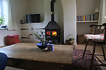 Domestic stove warm coal fire in domestic home, UK