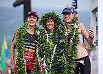 KONA-KAILUA, HI - OCTOBER 11:  Mirinda Carfrae, Daniela Ryf, and Rachel Joyce at the finish line at the 2014 IRONMAN Triathlon World Championships presented by GoPro on October 11, 2014 in Kailua-Kona, Hawaii. (Photo by Donald Miralle) *** Local Caption ***