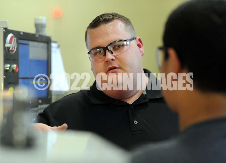 FAIRLESS HILLS, PA - NOVEMBER 5: Marcello Scacciotti (R), of Bristol, Pennsylvania is given instructions by Chuck Raybold (L) in Machine Technology at Bucks County Technical High School November 5, 2014 in Fairless Hills, Pennsylvania.  (Photo by William Thomas Cain/Cain Images)