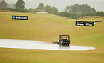 The greenkeepers have abandonded their ball recoevery vehicle as it gets stuck in the edge of the water on the driving range during the storm delayed second round  of the Barclays Scottish Open, played over the links at Castle Stuart, Inverness, Scotland from 7th to 10th July 2011:  Picture Stuart Adams /www.golffile.ie 9th July 2011