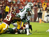 New York Jets running back Bilal Powell (29) carries the ball in the first quarter against the Washington Redskins at FedEx Field in Landover, Maryland on Thursday, August 16, 2018.  Defending on the play is Washington Redskins linebacker Zach Brown (53).<br /> Credit: Ron Sachs / CNP<br /> (RESTRICTION: NO New York or New Jersey Newspapers or newspapers within a 75 mile radius of New York City)