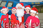 SANTAS HELPERS: Oisin O'Leary, Donnagh Fahy, Ella Kehoe and Olywn Evans pictured with Santa when he arrived at Deenagh Farm Montessori school by helicopter on Thursday 18th December.   Copyright Kerry's Eye 2008