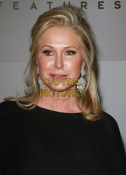 KATHY HILTON.NBC Universal 68th Annual Golden Globe Awards After Party held at the Beverly Hilton, Beverly Hills, California, USA..January 16th, 2011.headshot portrait earrings black  .CAP/ADM/KB.©Kevan Brooks/AdMedia/Capital Pictures.