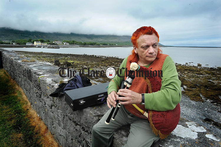 Piper Jean Pierre Goudrand from Montpelier in France adds his own touvh of colour to the Festival of The Valleys in Ballyvaughan. photograph by John Kelly.