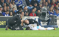 Stuart Dallas of Leeds United is seen to by medics during the Sky Bet Championship match between Cardiff City and Leeds United at The Cardiff City Stadium, Cardiff, Wales, UK. Tuesday 26 September 2017