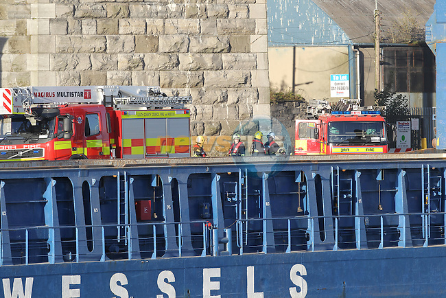 Two Units of Drogheda fire service assisted wight he removal of a casualty from the bottom of the hold in a ship docked in Drogheda port..The fire service personnel assisted paramedics from the Ambulance service in stabilising the casualty and then using there hydraulic platform to lift the casualty and stretcher from the hold onto the quay side. The casualty is believed to have been involved in an accident with a piece of machinery in the hold of the cargo ship..Picture: Fran Caffrey/www.newsfile.ie.