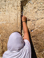 Israel,Jerusalem, orhodox judes woman prays at the Western Wall