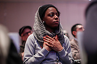 "A woman prays as she attends the ""Impact of Police Brutality"" panel during the 2015 NAN Convention in New York City. 04.08.2015. Kena Betancur/VIEWpress."