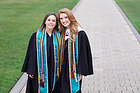 Graduates on the Drill Field: Megan Costilow (political science) and Molly May (communication/public relations).<br />